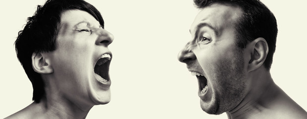 Man and woman yell at each other on white isolated background.