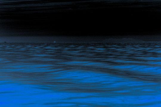 Blue ocean by night