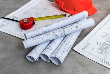 Engineer workplace . Blueprint rolls and engineering tools.