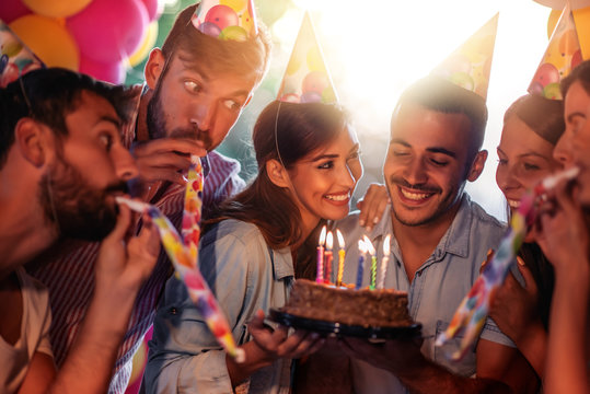Group of friends celebrating birthday together