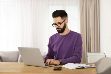 Door stickers Wall Decor With Your Own Photos Handsome young man working with laptop at table in home office