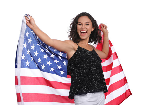 Happy young woman with American flag on white background