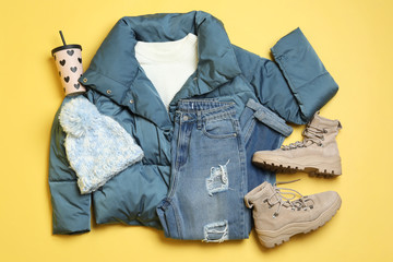 Fototapete - Flat lay composition with winter clothes and boots on yellow background