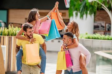 Friends enjoying shopping in the city