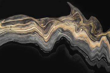 Golden marble wave zigzag on black. Abstract background or texture. Acrylic Fluid Art