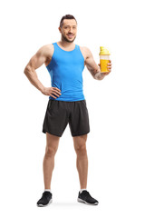 Young muscular man in sportswear with a protein shake