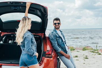 Fotomurales - blonde woman and handsome man in denim jackets looking at each other