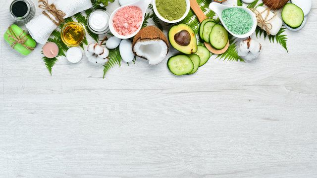 Natural Cosmetics: Avocado, coconut, sea salt and face cream. The concept of cosmetics and spa. Top view. Free copy space.