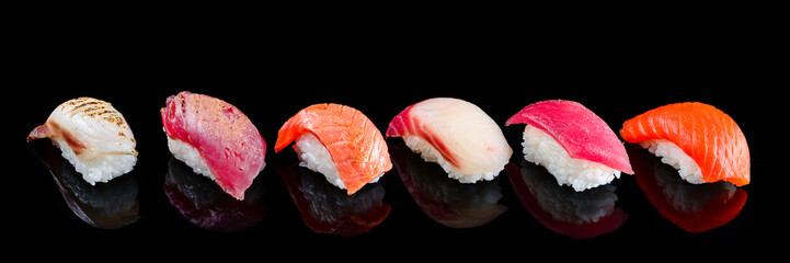 Foto op Aluminium Sushi bar sushi set nigiri on a black background