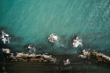 Aerial view of sea waves and Rocky coast