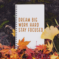Inspirational and motivation quote notebook with maple leaf in autumn background with vintage filter.