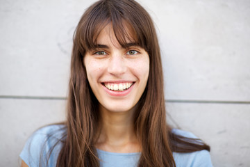 front portrait of young woman with big smile and long hair