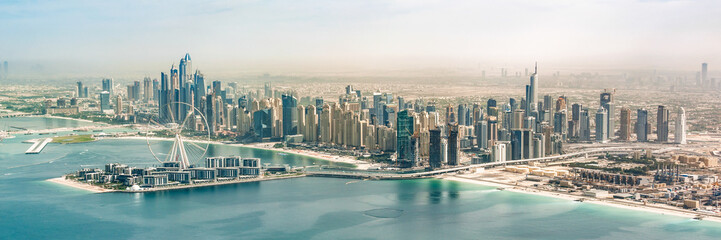Papiers peints Dubai Panoramic aerial view of Dubai Marina skyline with Dubai Eye ferris wheel, United Arab Emirates