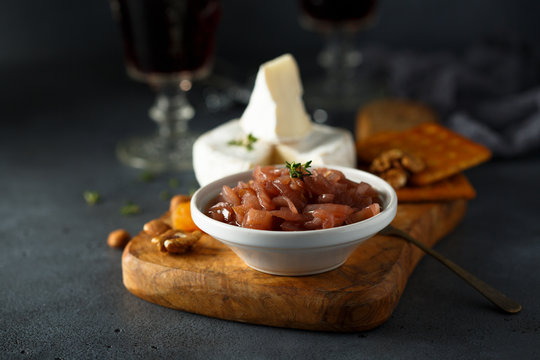 Homemade onion jam served with cheese and nuts