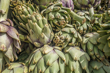 background of fresh juicy artichokes in the market close up