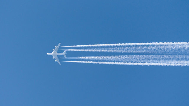 four-engined jet aircraft, jet airbus a380 airplane in the sky with condensation stripes