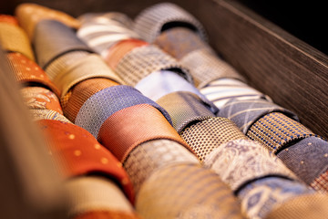 Ties for sale arranged in shop