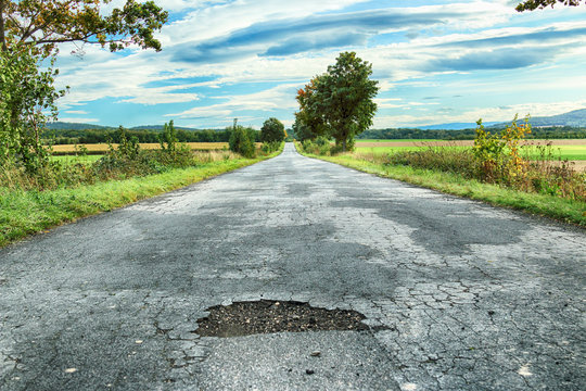 Dangerous hole in the road.