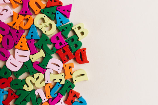 Colorful small scattered wooden letters