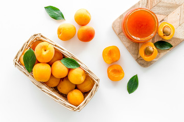 Friut background with apricot jam on white background top view