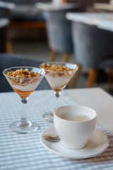 Photo Blinds Coffee beans Granola in glass ice-cream bowls. close-up.