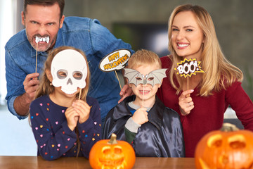 Portrait of family in Halloween masks