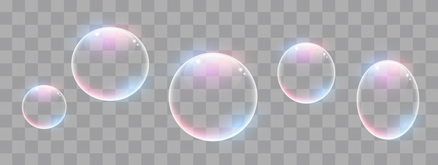 Realistic soap bubbles with rainbow reflection set isolated.