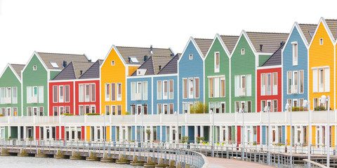 Colorful wooden newly built houses in Houten The Netherlands isolated on white