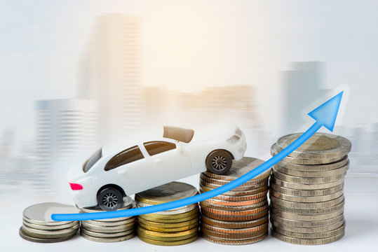 Car on the stacked coins in concept investment, money, finance.