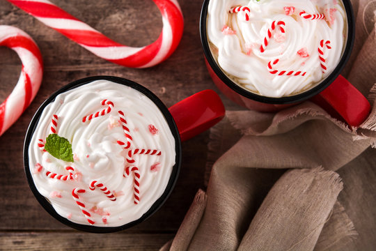 Peppermint coffee mocha for Christmas on wooden table. Top view