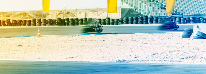 motorcycle racer rides on a sports track Wall mural