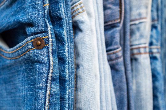 denim blue jeans stack texture background closeup