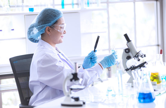 Asian woman scientist, researcher, technician, or student conducted research in laboratory