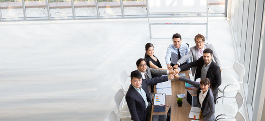 Top view of successful startup entrepreneurs and business people team achieving goals. Aerial view with teamwork of businessman and businesswoman. Business meeting concept