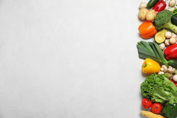 Fresh vegetables on light grey background, flat lay. Space for text