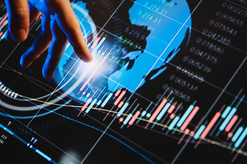 Wall Mural - Businessman is pointing on a hi technology futuristic digital screen with financial analytics