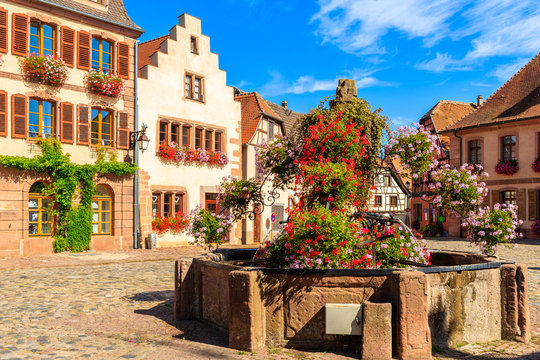 Colorful houses on square in Bergheim village on Alsatian Wine Route, France