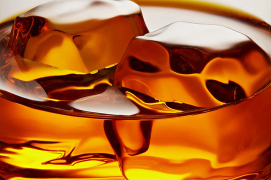 Glass of elegant whiskey with ice cubes