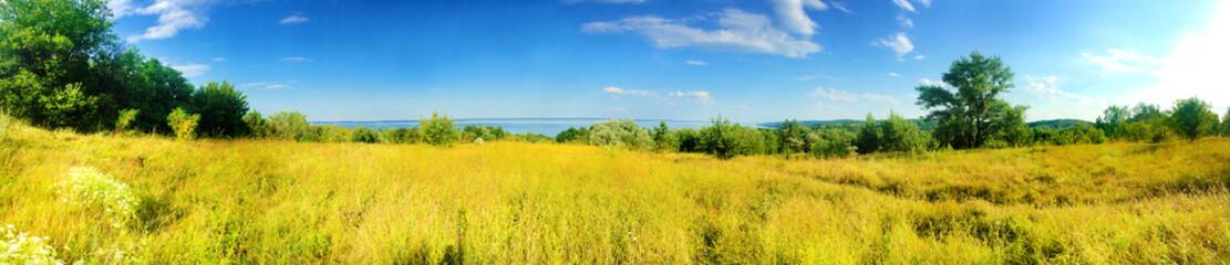 Foto auf AluDibond Orange Beautiful panorama of Kaniv Reservoir shore, Ukraine, in sunny day with bright blue sky