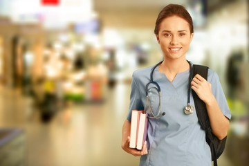 Nurse student with books and stethoscope