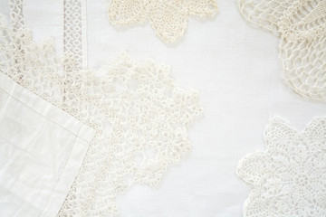 Layered lace doily and linen background shot from above as graphic resource and design element
