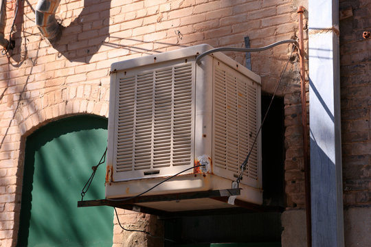 Swamp cooler hanging from the side of a building in Bisbee, AZ