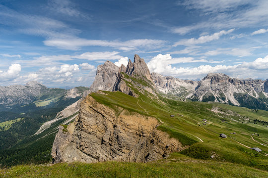 One suny day at the Seceda peaks at the beautiful Val Gardena valley in Dolomites mountains, Alps, Italy.