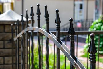 Metal fashion fence. Decorative wrought iron fence Fototapete