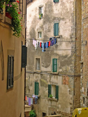 Italy, Tuscany, Cortona life in a medieval building.