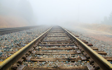 Foto auf Acrylglas Eisenbahnschienen Railroad Tracks in the Fog