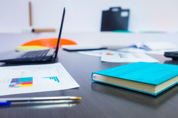 Financial reports and charts on a office table
