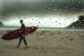 Surfer Though Rainy Window