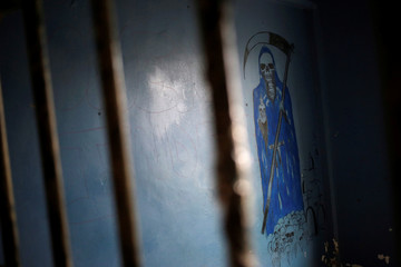 An image of La Santa Muerte (The Saint of Death), is pictured inside an empty cell of the Topo Chico prison, which will be converted to a public park, during a closing ceremony in Monterrey