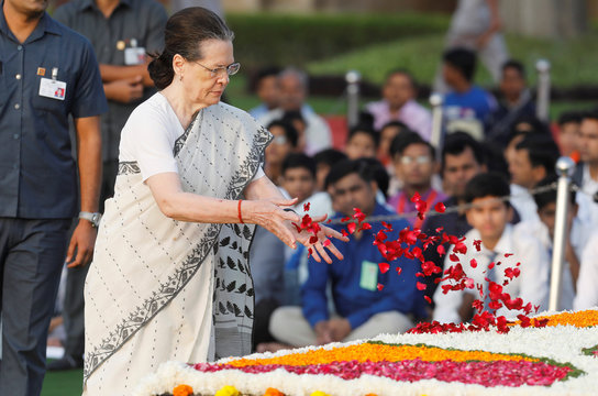 India's Congress Party chief Sonia Gandhi pays homage at the Mahatma Gandhi memorial on the 150th birth anniversary of Gandhi at Rajghat in New Delhi